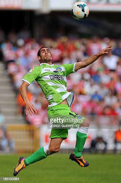 Getafe's defender Alvaro Arroyo controls the ball during the Spanish league football match Granada CF vs Getafe CF at the Nuevo Los Carmenes stadium...