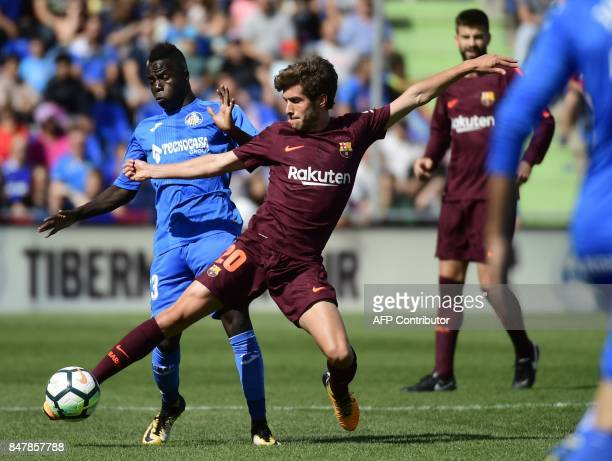 Getafe's forward from Senegal Amath Ndiaye Diedhiou vies with Barcelona's midfielder from Spain Sergi Roberto during the Spanish league football...