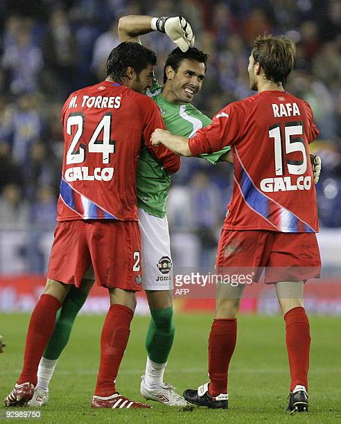 Getafe's goalkeeper 's Codina celebrates with teammates Miguel Torres and Rafa after Roberto Soldado scored during the Spanish Kings Cup match...