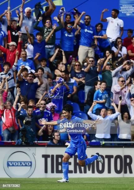Getafe's midfielder from Japan Gaku Shibasaki celebrates a goal during the Spanish league football match Getafe CF vs FC Barcelona at the Col Alfonso...