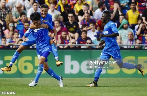 Getafe's midfielder from Japan Gaku Shibasaki celebrates a goal with teammates during the Spanish league football match Getafe CF vs FC Barcelona at...