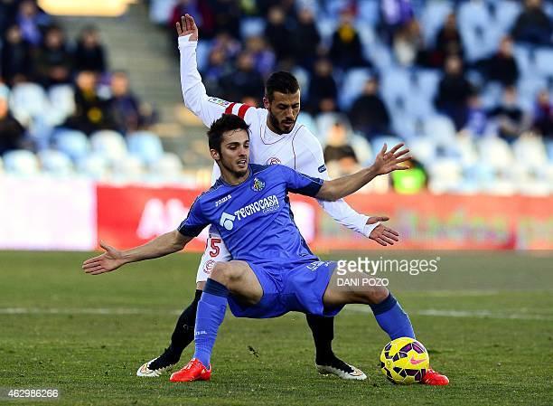 Getafe's midfielder Pablo Sarabia vies with Sevilla's Portuguese defender Diogo Figueiras during the Spanish league football match Getafe CF vs...