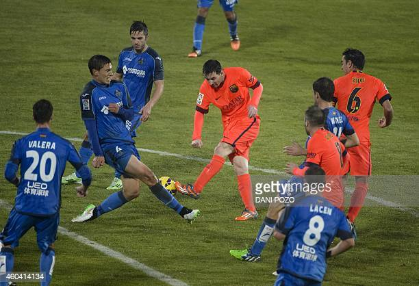 Getafe's Uruguayan defender Emiliano Velazquez vies with Barcelona's Argentinian forward Lionel Messi during the Spanish league football match Getafe...