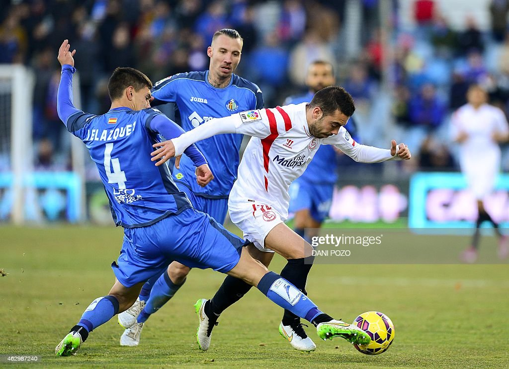 Getafe's Uruguayan defender Emiliano Velazquez (L) vies with Sevilla's forward <a gi-track='captionPersonalityLinkClicked' href=/galleries/search?phrase=Iago+Aspas&family=editorial&specificpeople=6700373 ng-click='$event.stopPropagation()'>Iago Aspas</a> during the Spanish league football match Getafe CF vs Sevilla FC at the Coliseum Alfonso Perez stadium in Getafe on February 8, 2015.