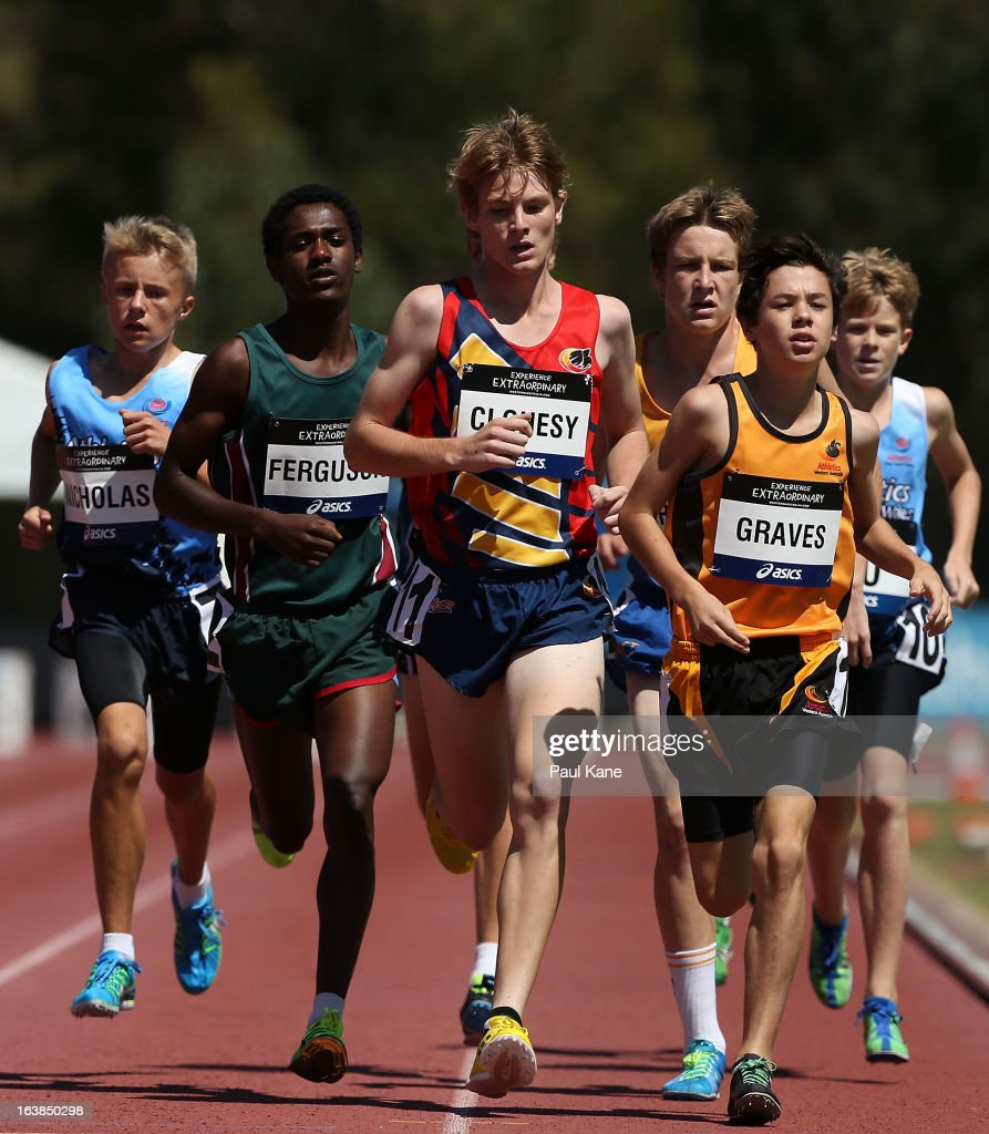Getasew Ferguson of Tasmania, Cameron Clohesy of South Australia and Luke Graves of Western Australia lead the field in the mens u15 1500 metre race during day six of the Australian Junior Championships at the WA Athletics Stadium on March 17, 2013 in Perth, Australia.
