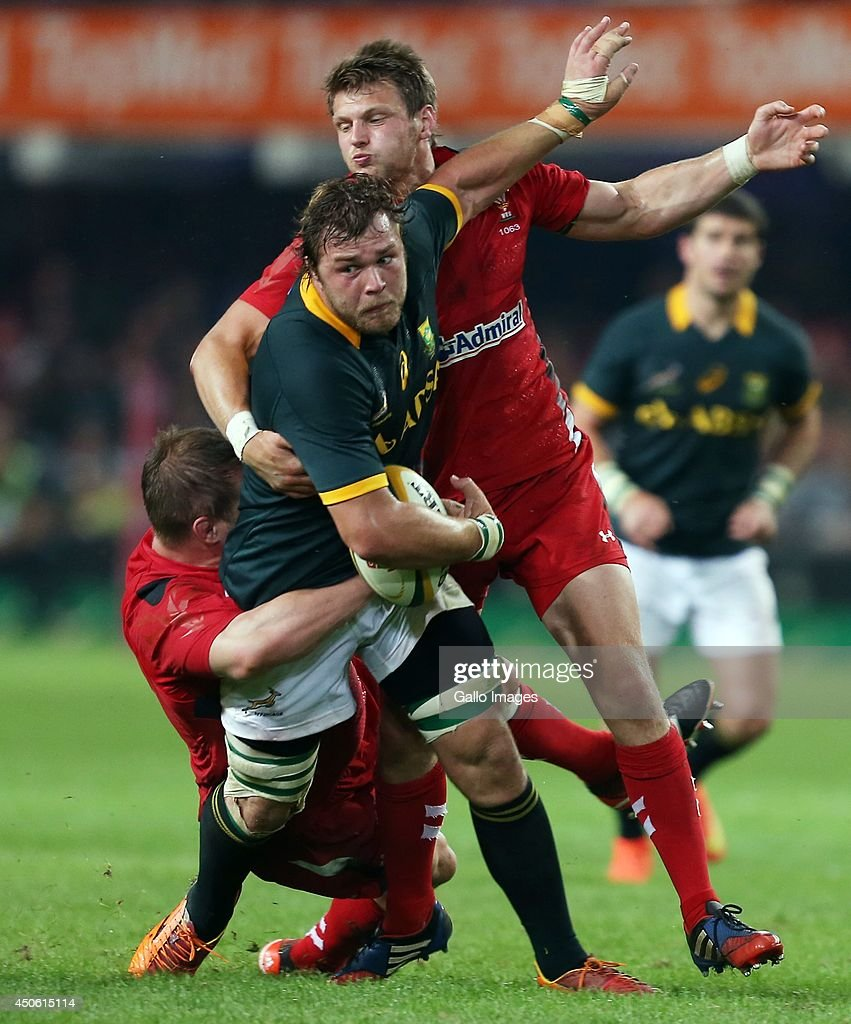 Gethin Jenkins and Dan Biggar of the Wales look to tackle Duane Vermeulen of South Africa during the Incoming Tour match between South Africa and Wales at Growthpoint Kings Park on June 14, 2014 in Durban, South Africa.