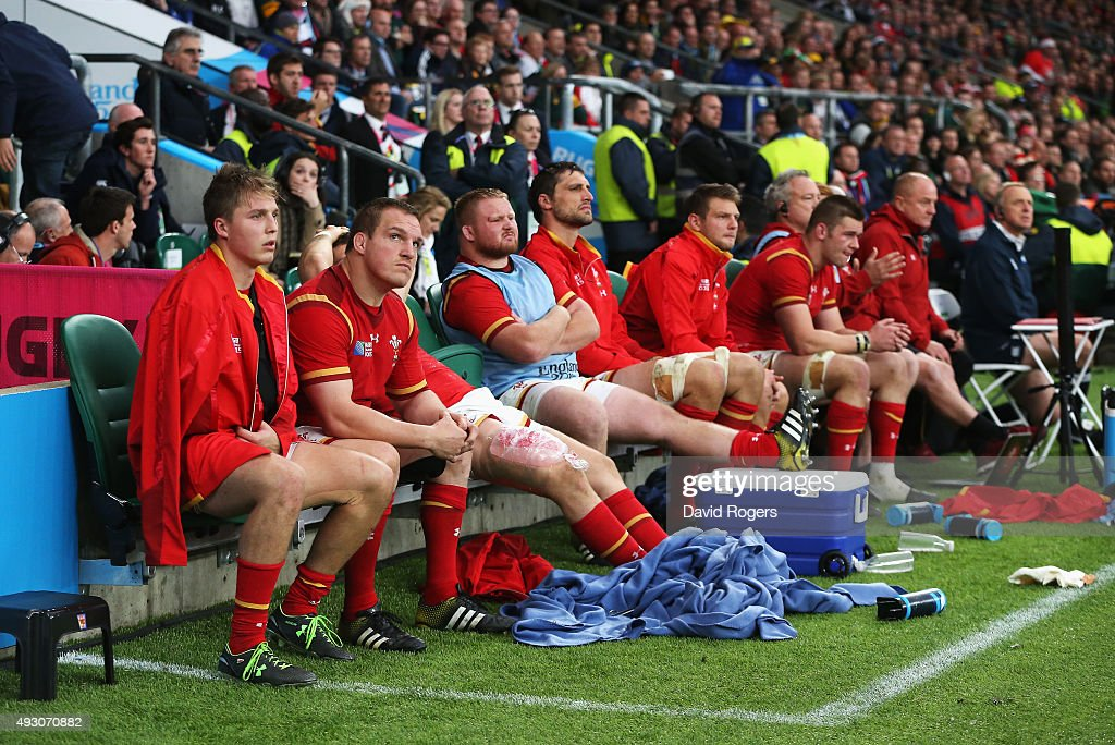 Gethin Jenkins of Wales (2L) looks up as the Wales replacements look dejected during the 2015 Rugby World Cup Quarter Final match between South Africa and Wales at Twickenham Stadium on October 17, 2015 in London, United Kingdom.