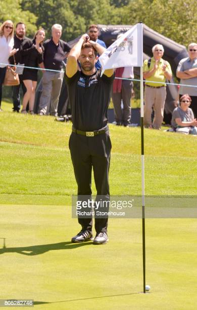 Gethin Jones hold his head as Sir Gareth Edwards putts for Wales and just misses on the last hole of Day one of the Celebrity Cup at Celtic Manor...