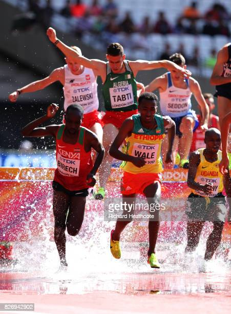 Getnet Wale of Ethiopia and Jairus Kipchoge Birech of Kenya competes in the Men's 3000 metres Steeplechase heats during day three of the 16th IAAF...