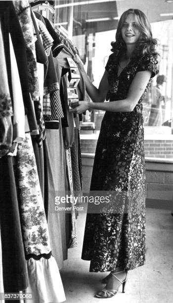 Getting A Glow on At Goodwill Cara Meyers tries on a pink sweater left and a floral evening dress Credit Denver Post