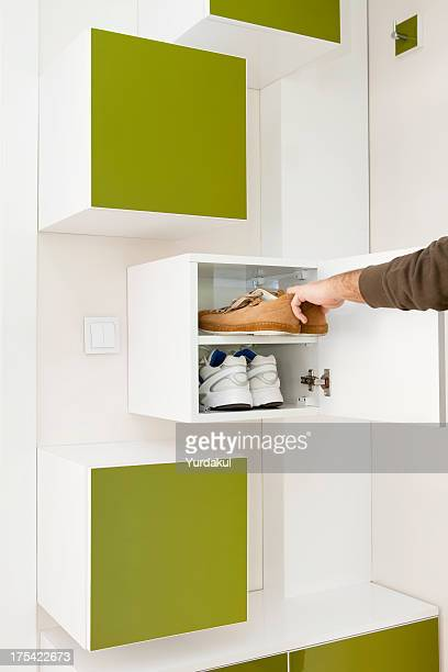 getting shoes from shoe cabinet