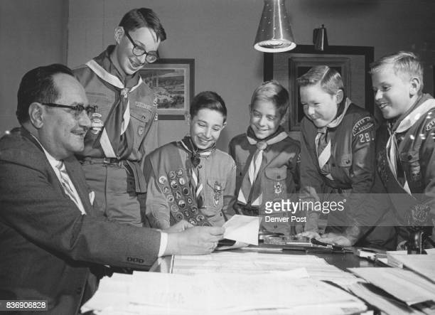 Getting visitor's visas to Mexico from the Mexican consul in Denver left to right Thornton Hector Jara are Scouts Philip Turetzky 9924 Pennsylvania...