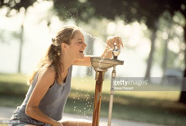 Getting wet at drinking fountain