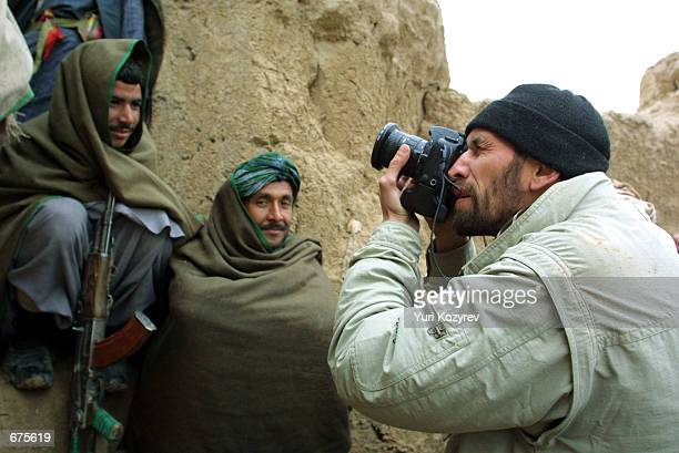 Getty Images photographer Oleg Nikishin takes pictures November 30 2001 at a Northern Alliance base near MazariSharif Afghanistan