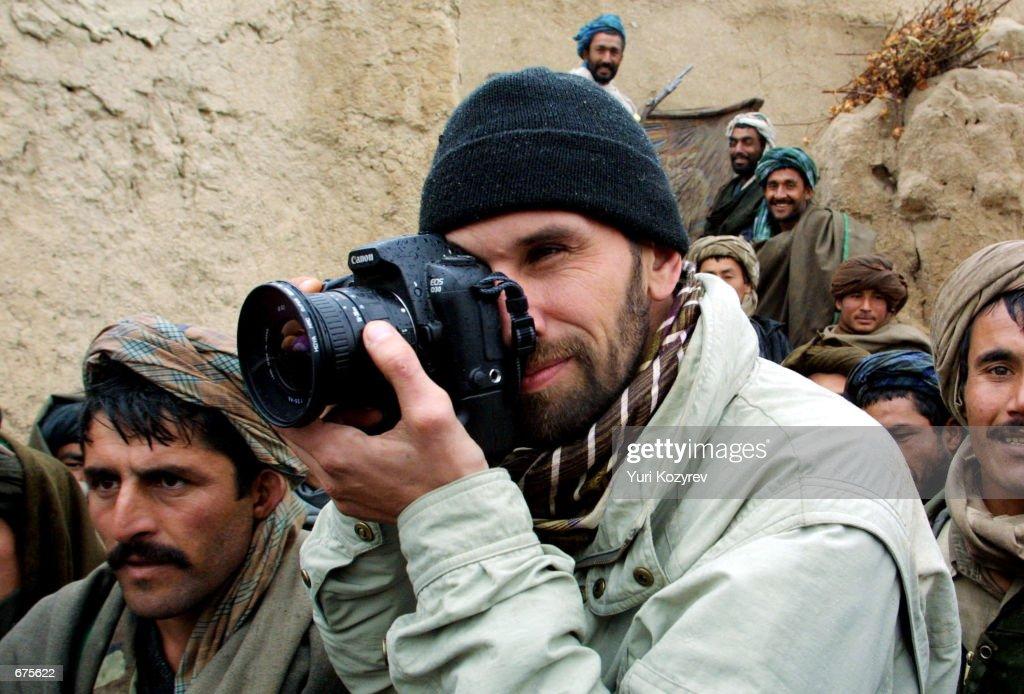 Getty Images photographer Oleg Nikishin takes pictures November 30 2001 at a Northern Alliance base near MazariSharif Afghanistan