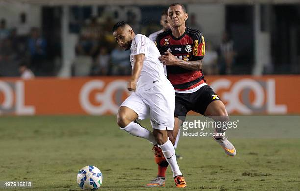 Geuvanio of Santos fights for the ball with Alan Patrick of Flamengo during a match between Santos v Flamengo of Brasileirao Series A 2015 at Vila...