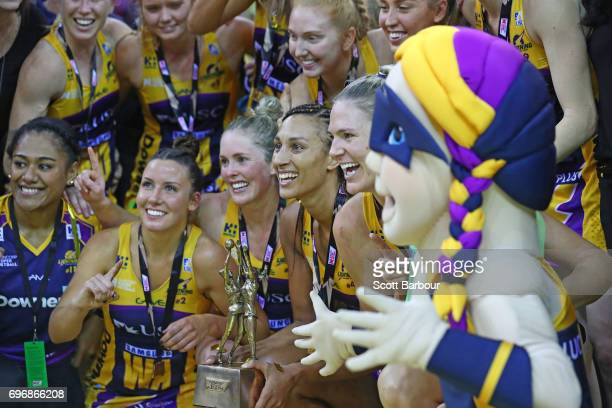 Geva Mentor captain of the Sunshine Coast Lightning and her teammates pose for a team photo with the Suncorp Super Netball trophy after winning the...