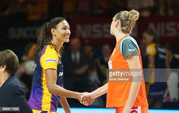 Geva Mentor captain of the Sunshine Coast Lightning and Jo Harten captain of the Giants shake hands after the coin toss during the Super Netball...
