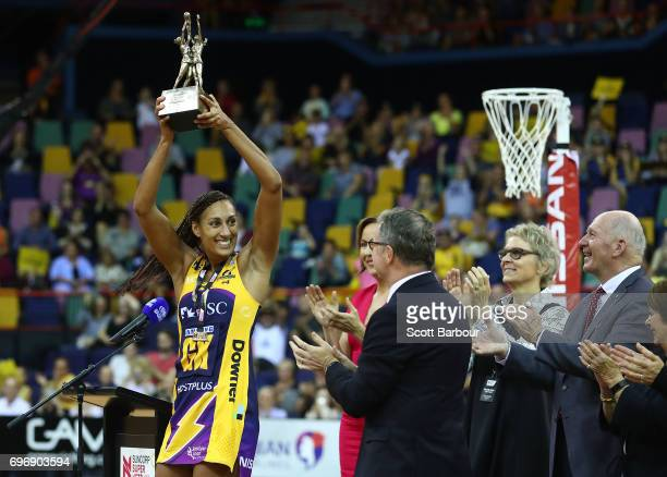 Geva Mentor captain of the Sunshine Coast Lightning holds the Suncorp Super Netball trophy aloft after winning the Super Netball Grand Final match...