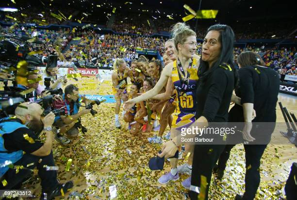 Geva Mentor coach Noeline Taurua and the Lightning pose for a team photo with the Suncorp Super Netball trophy after winning the Super Netball Grand...