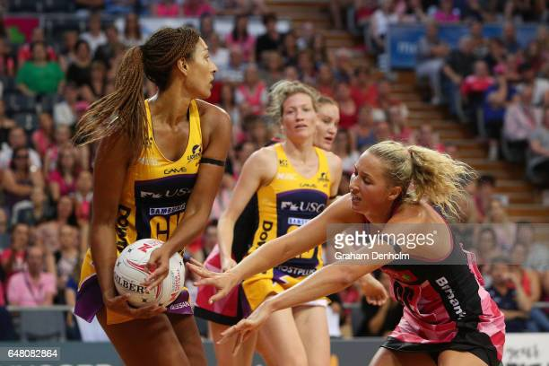 Geva Mentor of the Lightning is put under pressure by Erin Bell of the Thunderbirds during the round three Super Netball match between the...