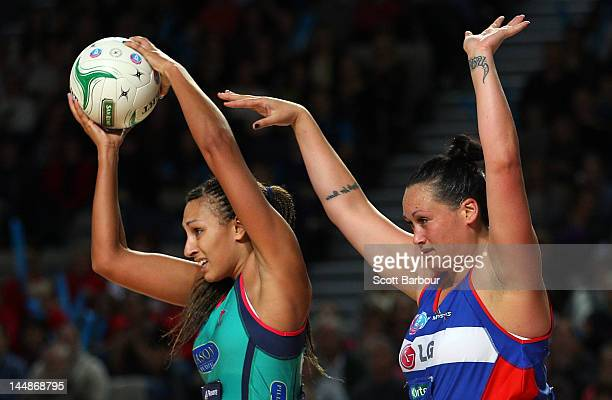Geva Mentor of the Vixens and Cathrine Latu of the Mystics compete for the ball during the round eight ANZ Championship match between the Melbourne...