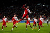 Gevero Markiet of Utrecht leaps in celebration after scoring the first goal of the game during the Dutch Eredivisie match between FC Utrecht and NEC...