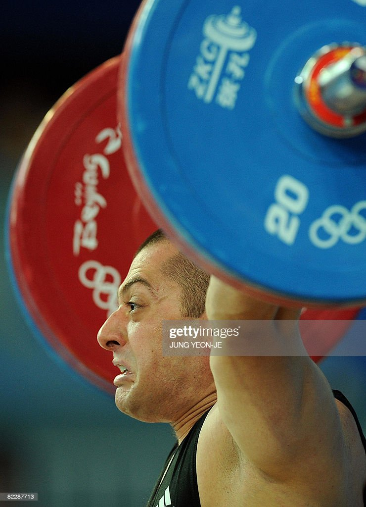 Gevorg Davtyan of Armenia competes in the men's 77 kg weightlifting event during the 2008 Beijing Olympic Games at the Beijing University of Aeronautics and Astronautics Gymnasium on August 13, 2008.