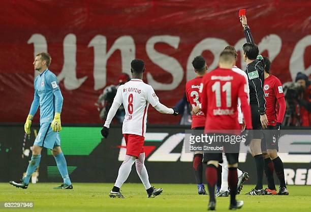 Ggoalkeeper Lukas Hradecky of Eintracht Frankfurt is shown a red card by referee Deniz Atekin during the Bundesliga match between RB Leipzig and...
