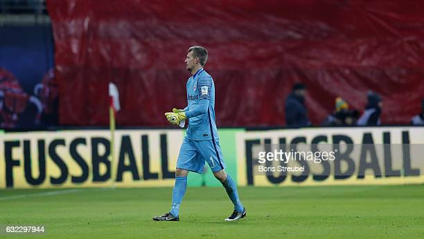 Ggoalkeeper Lukas Hradecky of Eintracht Frankfurt leaves the pitch after receiving a red card during the Bundesliga match between RB Leipzig and...