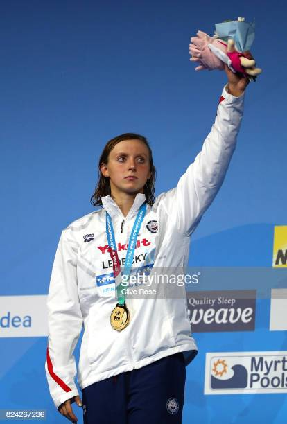 Ggold medalist Katie Ledecky of the United States poses with the medal won during the Women's 800m Freestyle final on day sixteen of the Budapest...