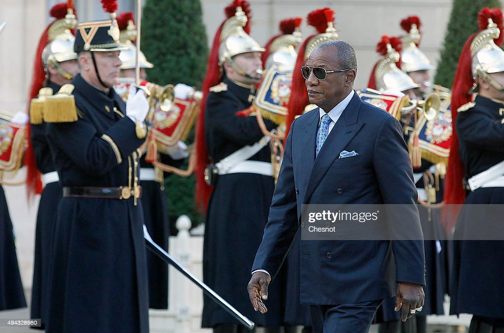 French President Francois Hollande Receives Guinea President Alpha Conde At Elysee Palace In Paris