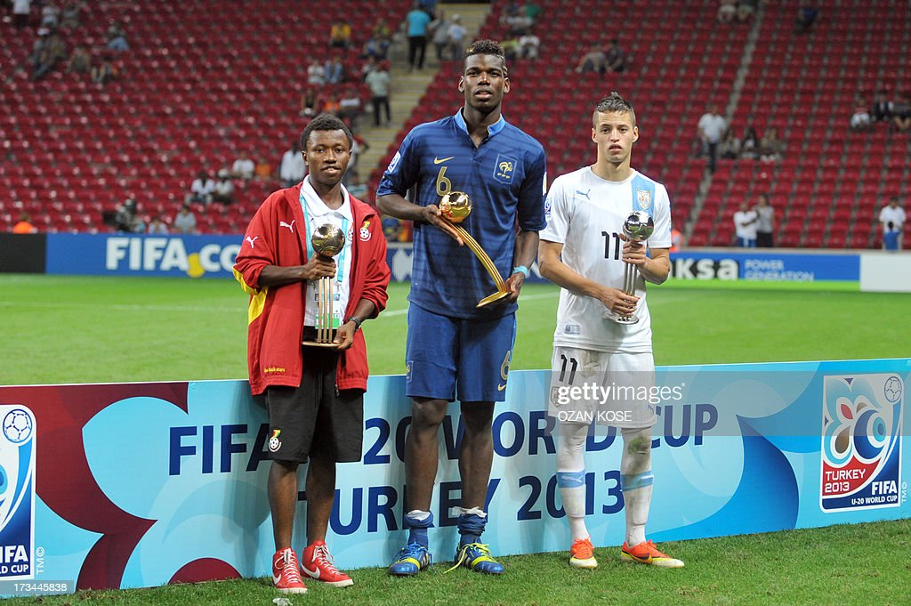 Ghana' midfielder Clifford Aboagye (L), France's Paul Pogba (C) and Uruguay's forward Nicolas Lopez (R) pose with their trophies after the FIFA Under 20 World Cup final football match between France and Uruguay at Turk Telecom Stadium in Istanbul on July 13, 2013. France won the title, Uruguay placed second and Ghana third. AFP PHOTO / OZAN KOSE