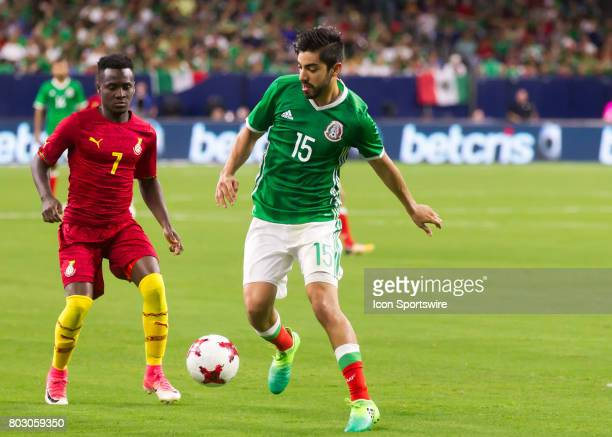 Ghana midfielder David Accam and Mexico forward Rodolfo Pizarro fight for ball during the Mexico vs Ghana friendly soccer match at on June 28 2017 at...