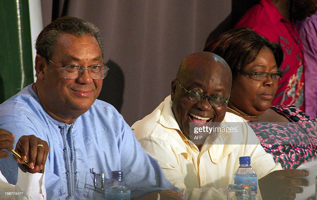Ghana opposition presidential candidate Nana Akufo-Addo (C) laughs next to New Patriotic Party Chairman Jake Obetsebi-Lamptey (L) at a press conference on December 28 in Accra. Ghana's main opposition, alleging electoral fraud, filed a court challenge today to results from this month's presidential polls handing victory to incumbent John Dramani Mahama. Opposition candidate Nana Akufo-Addo of the New Patriotic Party told journalists after the party filed the challenge with the supreme court that the discrepancies they are alleging were too large to ignore.