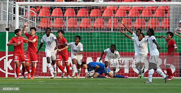 Ghana players are convinced the ball has crossed the line after a save by goalkeeper Kim Chol Ok of Korea DPR during the FIFA U20 Women's World Cup...