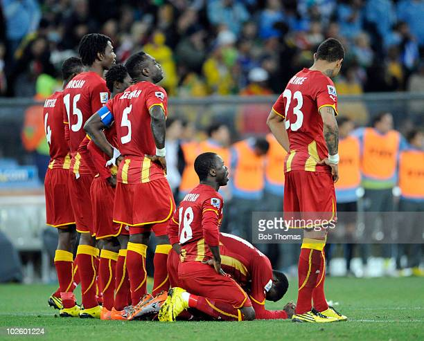 Ghana players watch the penalty shoot out during the 2010 FIFA World Cup South Africa Quarter Final match between Uruguay and Ghana at the Soccer...