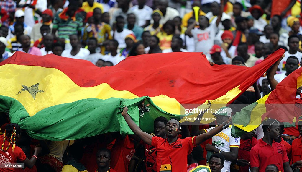 Ghanaian fans cheer during the 2014 World Cup African qualifying first leg play-off match between Ghana and Egypt on October 15, 2013 at Baba Yara Stadium in Kumasi of Ashanti, Ghana.