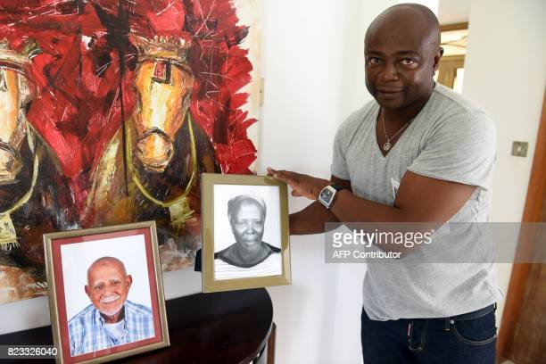 Ghanaian football legend Abedi Ayew known professionally as Abedi Pele shows a portrait of his mother as he speaks about his career at his home in...