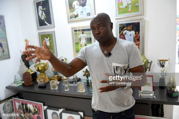 Ghanaian football legend Abedi Ayew known professionally as Abedi Pele gestures as he speaks about his career at home in Accra on July 13 2017 Former...