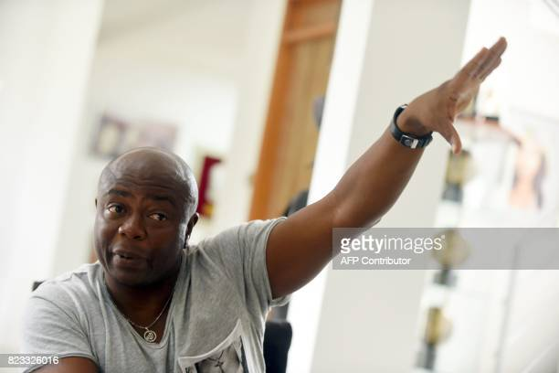 Ghanaian football legend Abedi Ayew known professionally as Abedi Pele gestures as he speaks about his career at his home in Accra on July 13 2017...