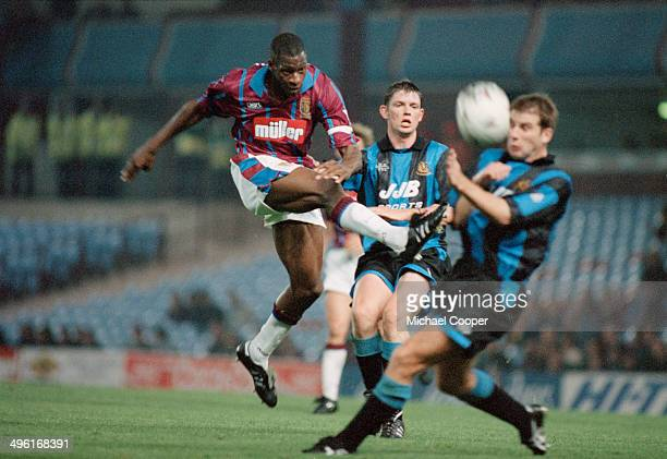 Ghanaian footballer Nii Lamptey in action for Aston Villa against Wigan Athletic in an English League Cup Second Round 1st Leg match at Villa Park...