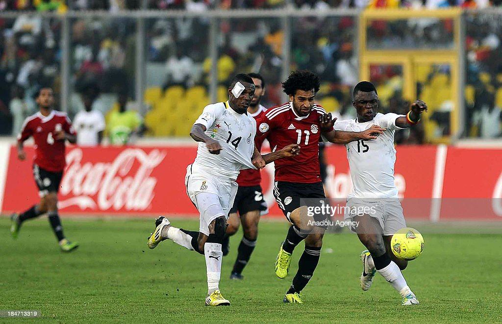 Ghanaian Jerry Akaminko (L2) and Rashid Sumaila (R) vie with Egyptian Mohamed Salah (R2) during the 2014 World Cup African qualifying first leg play-off match between Ghana and Egypt on October 15, 2013 at Baba Yara Stadium in Kumasi of Ashanti, Ghana.