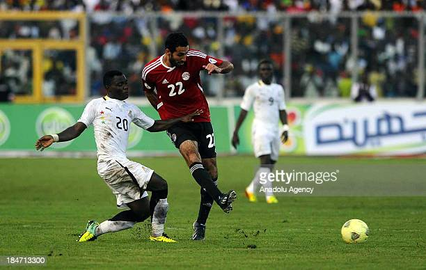Ghanaian Kwadwo Asamoah and Egyptian Mohamed Aboutrika vie for the ball during the 2014 World Cup African qualifying first leg playoff match between...