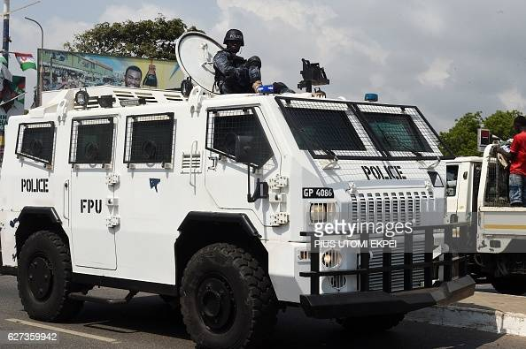 A Ghanaian Police Force vehicle parades along a street in Accra on December 3 2016 in a show of force ahead of the December 7 elections Presidential...