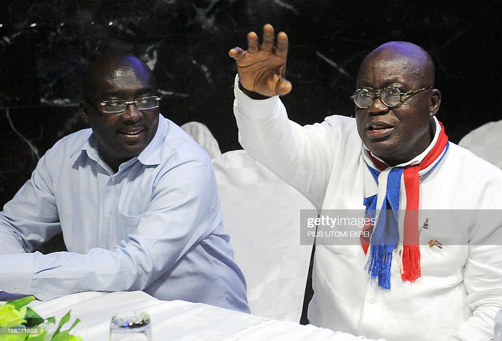 Ghanaian Presidential candidate for the opposition New Patriotic Party Nana Akufo-Addo (R) raises his hand beside Vice-presidential candidate Mahamudu Bawumia in Accra on December 11, 2012 during a meeting to disccuss planned legal action to challenge Ghana's presidential election results. Ghana's main opposition party said on December 11 it planned to challenge presidential election results in court after having alleged a 'pattern of fraud' in incumbent John Dramani Mahama's victory. AFP PHOTO / PIUS UTOMI EKPEI