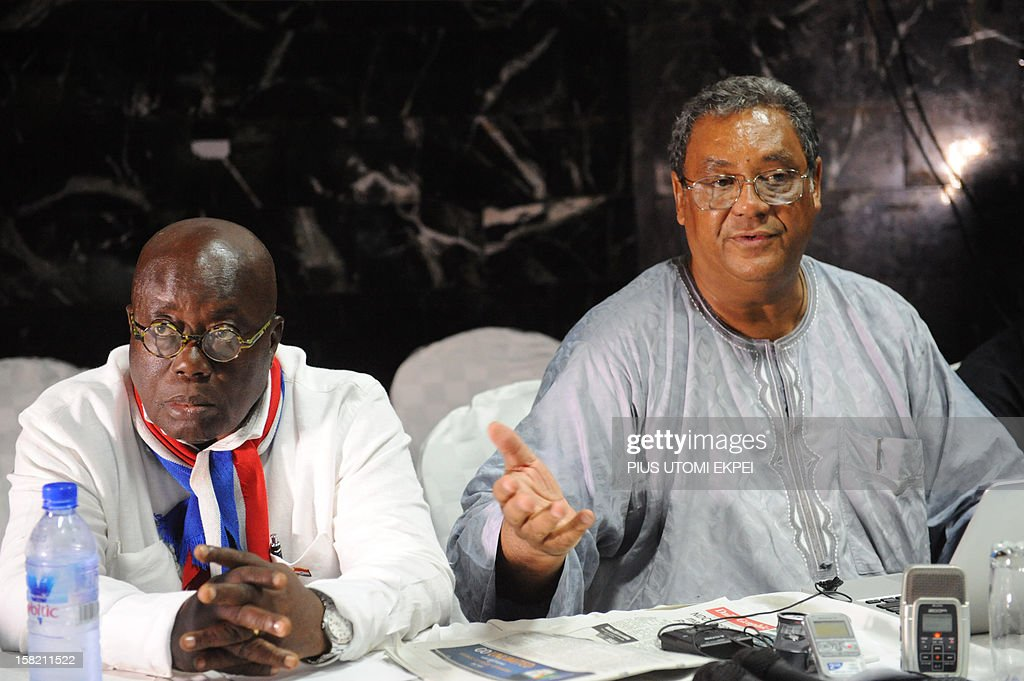 Ghanaian Presidential candidate for the opposition New Patriotic Party Nana AkufoAddo looks on as party chairman Jake ObetsebiLamptey speaks in Accra...