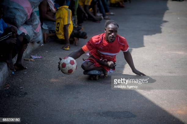 Ghanaian teenager who contracted polio and lost his walking ability is seen with his friends in Tudu district of Accra Ghana on May 14 2017 Teenagers...