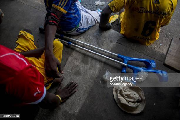 Ghanaian teenagers who contracted polio and lost their walking ability are seen in Tudu district of Accra Ghana on May 14 2017 Teenagers who maintain...