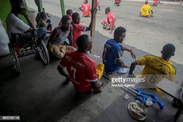 Ghanaian teenagers who contracted polio and lost their walking ability are seen as they rest in Tudu district of Accra Ghana on May 14 2017 Teenagers...
